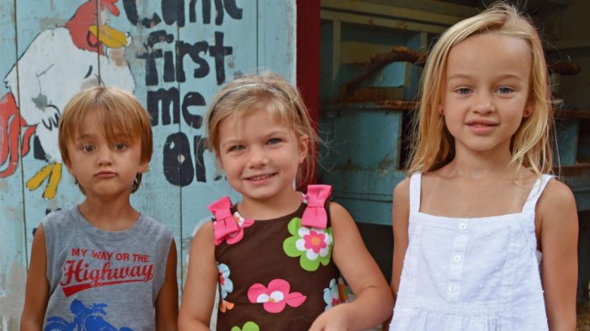 Little Sprouts Montessori School students collect eggs