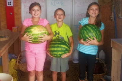 Holding watermelons